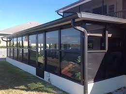enclosing a patio into a sunroom or