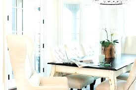 white french dining table with black top and tufted chairs round 6