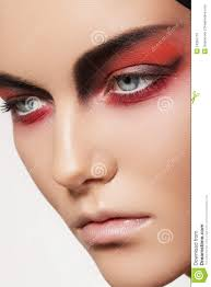 close up beauty portrait of attractive model face with bright fashion make up devil style visage for