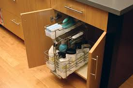 under the sink pull out caddy from dura supreme cabinetry for storing cleaning supplies