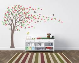 large tree wall decal with colorful leaves blow in the wind nursery stickers on wall art stickers family tree with family tree wall decals vinyl wall art stickers
