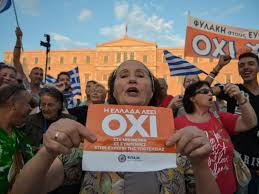some of the reasons greece got into its economic crisis   abc newsphoto  a w  holds a flyer which reads greece says no during a mass anti
