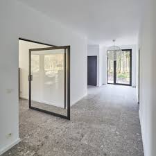 custom made pivoting glass door with a black frame