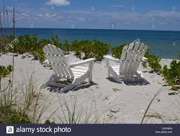 Adirondack chairs on beach Beach Two Adirondack Chairs On Beach Alamy Two Adirondack Chairs On Beach Stock Photo 59353137 Alamy