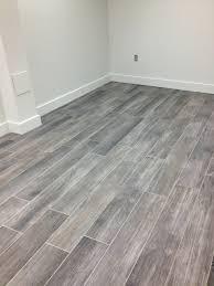 ceramic tile hardwood floor transition wood dark plankrado flooring