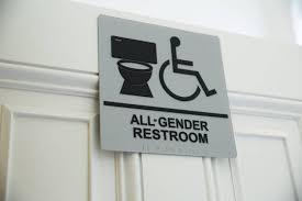nyc bathroom law. a sign for gender-neutral bathroom at new york city hall. nyc law c