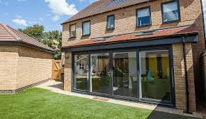 grey upvc sliding patio door with a wide span leading out onto garden