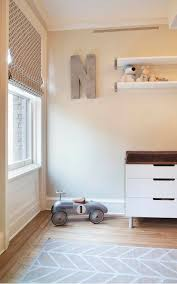 boy s nursery design with vintage racer car modern two tone chest white floating shelves zinc letter and gray chevron rug