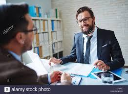 elegant businessman talking to interviewee stock photo royalty elegant businessman talking to interviewee