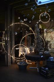 deck lighting ideas. spray paint hula hoops black string lights on them and hang from the ceiling deck lighting ideas