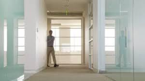 office hallway. Businessman Humorously Walking Down Office Hallway I