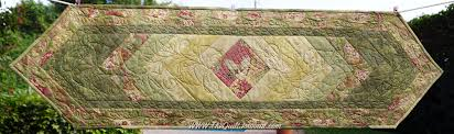Quilt as You Go or Free Motion Quilt Table Runner - The Quilt Journal & a picture of a table runner using the pattern Braid runner with free motion  quilting done Adamdwight.com