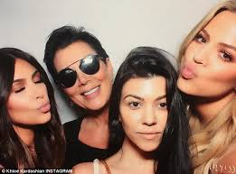 strike a pose she is seen with sisters kim and khloe and their mother kris