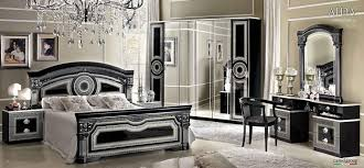 mirrored black bedroom furniture with beautiful chandelier