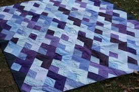 My Fabric Obsession: Boomerang quilt & Once the quilt top was put together un-quilted, I realized it need custom  quilting or the pattern was going to disappear. Adamdwight.com
