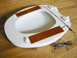 heated toilet seat cover. the heated toilet seat cover w