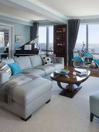 Grey sectional sofa with turquoise and brown room accents...love this