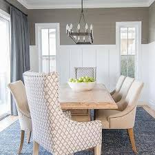 blue and gray dining room with gray grcloth and board and batten trim