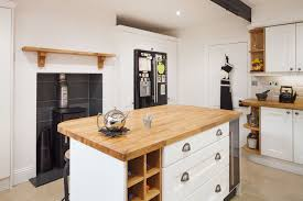 White wood kitchen Traditional The Wood Burning Stove In This White Wood Kitchen Gives It Strong Country Style Solid Wood Kitchen Cabinets Different Ways To Style White Wood Kitchen Solid Wood Kitchen