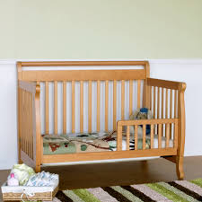 wooden crib that converts to toddler bed