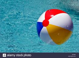 swimming pool beach ball background. Brightly Colored Beach Ball Floating In Swimming Pool With Copy Space - Stock Image Background K