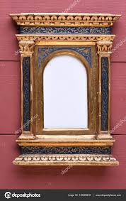 antique gold wood frame in the floine style on wooden wall photo by zetor2010