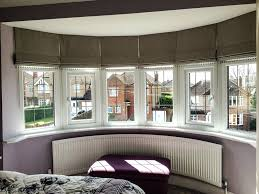 curtains blinds gallery curtains roman blinds in a bay window blinds  curtains blinds uk