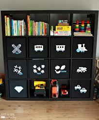 Living Room Storage For Toys A Storage Solution For Big Toys And An Ikea Hack Just A Girl