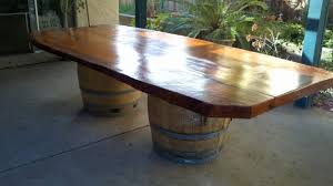 a simple wine barrel dining table