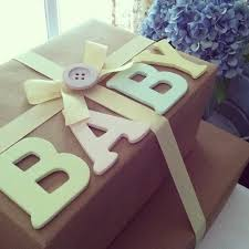 Another cute diaper gift wrapping idea! I an thinking this letters would  look great with washi tape instead of painting.
