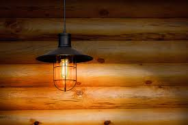 t14 led filament bulb 35 watt equivalent vintage light bulb radio style 12v ac dc installed in fixture in off grid cabin
