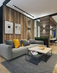a modern space with a light colored woodwall behind the sofa and a wood plank