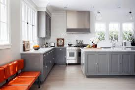 gray kitchen cabinets pictures smooth black granite countertop elegant glass elongated chandelier wall mounted white wooden cabinet classic black gas stove