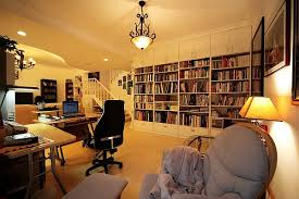 open space home office. design and construction living office space open room with home desk behind sofa c