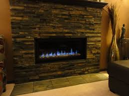 simple stone veneer fireplace surround along with big and tall glass vase also dark brown leather sofa