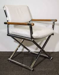 a pair of vintage director s chairs in white leather with a metal x base frame