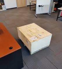 crate with machine inside