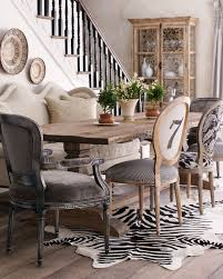 mismatched dining room chairs and zebra rug