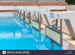blue water wave in swimming pool reflects with sunlight blue tile ceramic to swimming race