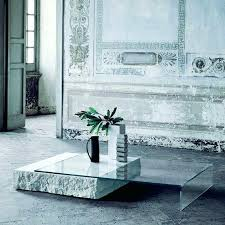 a gorgeous ultra minimalist coffee table with glass top and leg piece stone tables uk