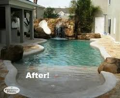 very small backyard pool. sun deck, grotto, slide
