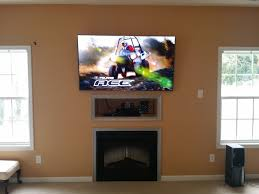 chic mounting tv over fireplace height