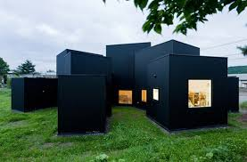 Small House, Large Influence With Black Facade, White Interiors