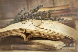 ancient photograph old books open on wooden table by sandra cunningham