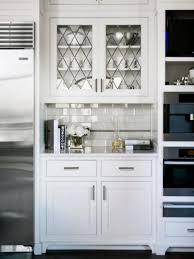 kitchen wall cabinet with glass doors styles for upper cabinets seeded door inserts home depot replacement etching designs pot organizer panels above