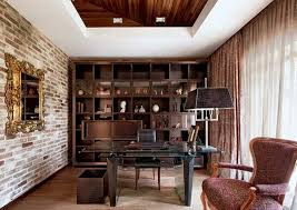 modern office shelving. Small Home Office Interior Design With Brick Wall And Large Mirror In Golden Frame, Contemporary Shelving Unit, Glass Top Desk, Classic Chairs, Modern