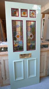 glazed exterior timber doors. a victorian style stained glass front door incorporating 3 over 2 glazed panels exterior timber doors