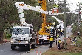 western power crews work on pole upgrades