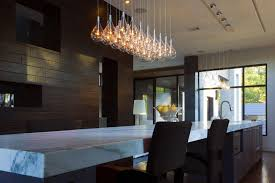 shaped modern pendant lighting fixture over a white granite topped kitchen island superb contemporary pendant chandeliers great pictures 2 850 x 567 jpg