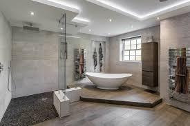 Wood tile flooring bathroom Wood Like Woodlook Tile Flooring Planks Grey Installed Throughout This Renovated Bathroom The Flooring Blog Installing Tile Where It Makes Sense